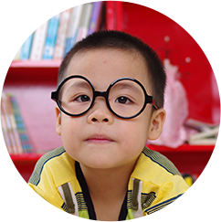 Kid with glasses looking at the camera